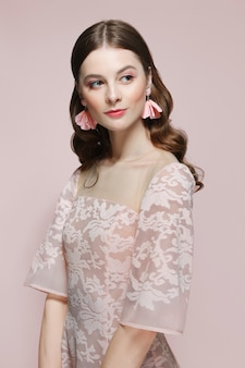 Beautiful fashion model in lace dress looking to the side. clean fresh face of pretty girl with natural makeup.