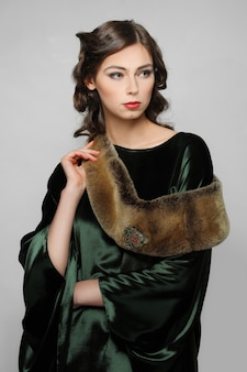 Beautiful fashion model in retro dress with fur collar. clean fresh face of pretty girl with natural makeup.