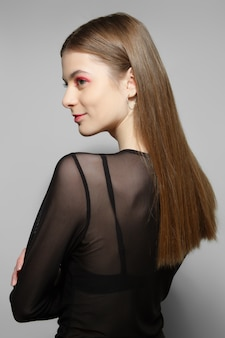 Beautiful fashion model in transparent blouse in profile. clean fresh face of pretty girl with natural makeup.