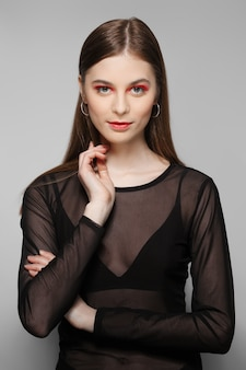 Beautiful fashion model with emphatic eyes and lips. clean fresh face of pretty girl with natural makeup.