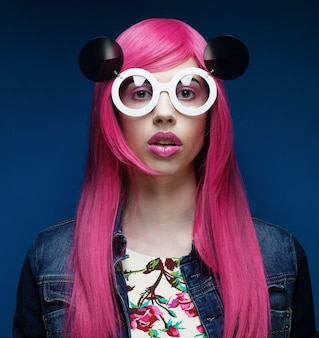 Beautiful fashion model with pink hair