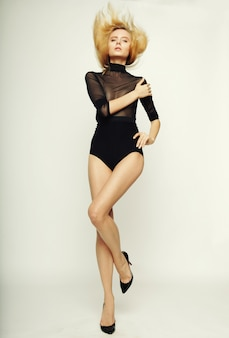 Beautiful fashion model woman with perfect slim body and long legs