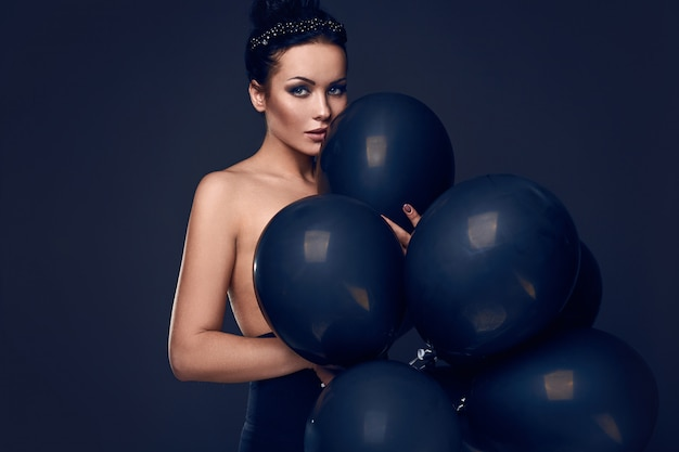 Beautiful fashion naked model girl with black balloons