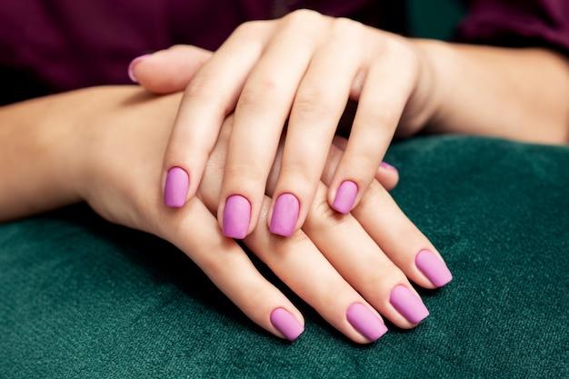 Beautiful fashion stylish purple matte manicure.
