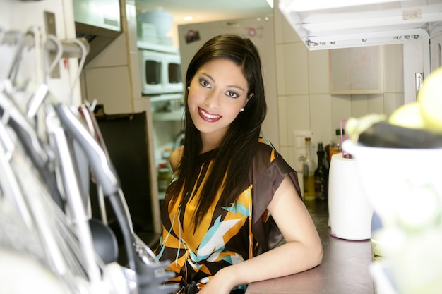 Beautiful fashion woman on the kitchen