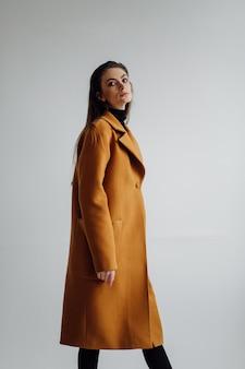 Beautiful fashion woman posing with elegant suit