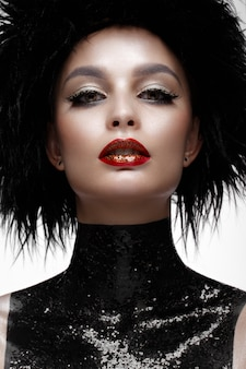 Beautiful fashion woman with creative make-up and black wig