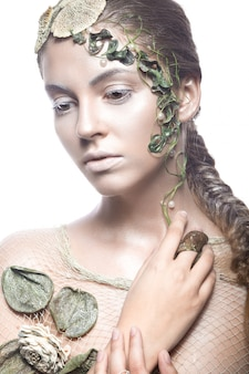 Beautiful fashionable girl in image of sea fairies with shells and algae