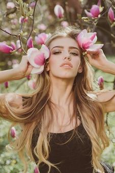 Beautiful and fashionable model girl in the garden. fashion model woman.