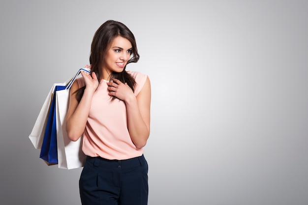 Beautiful fashionable woman with shopping bags