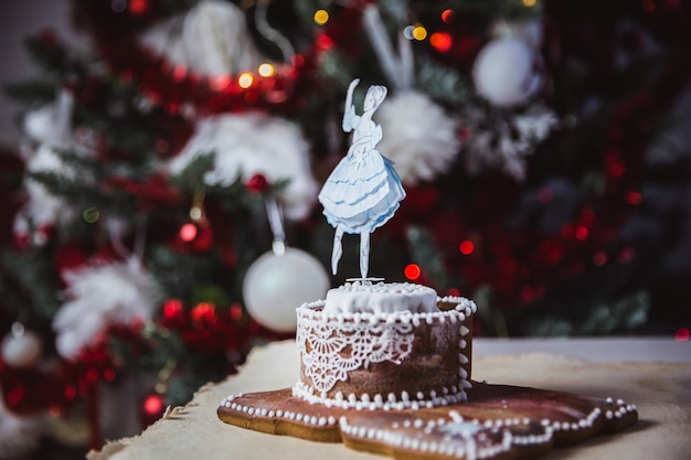 Beautiful female ballet dancer on music box made of gingerbread