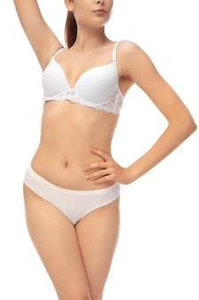 白で隔離の美しい女性の体