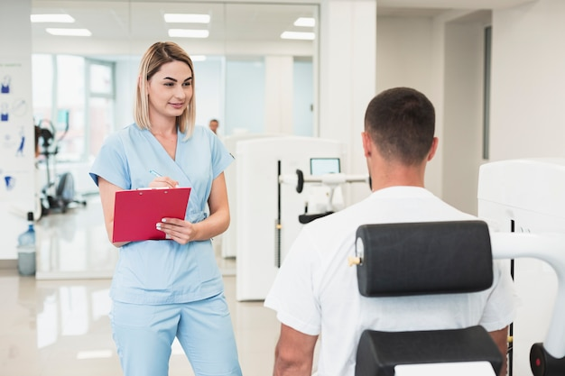 Beautiful female doctor checking patient condition