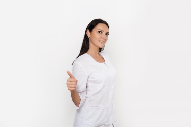 Beautiful female doctor in medical gown uniform, spa beauty treatment, skincare.  cosmetological clinic. healthcare, cosmetology, medicine concept.