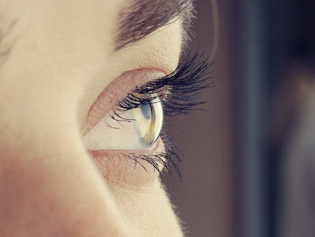 Beautiful female eye close up, looks away, vision correction concept, natural beauty with wrinkles