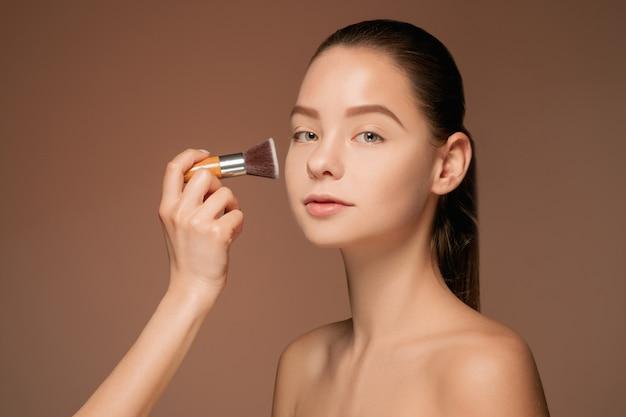 Beautiful female eyes with make-up and brush