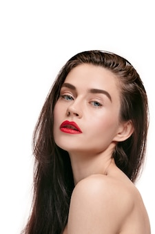 A beautiful female face. perfect and clean skin of young caucasian woman on white studio.