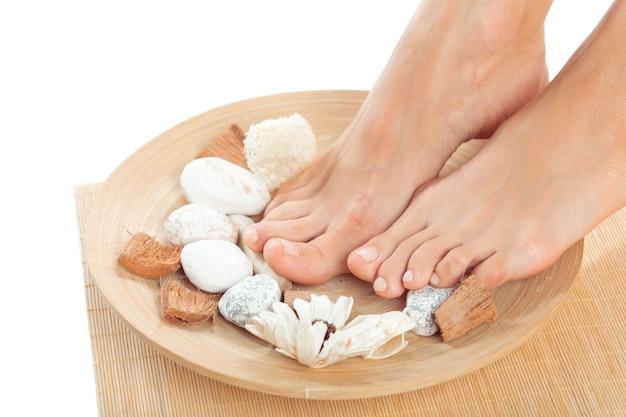 Beautiful female feet at spa salon