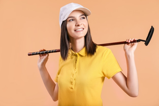 Beautiful female golfer on color background