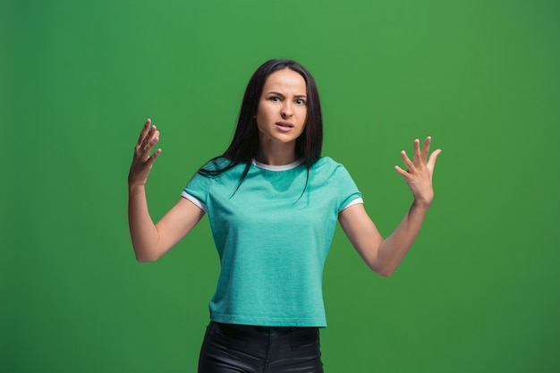 Beautiful female half-length portrait isolated on green studio