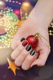 Beautiful female hand with christmas nail design