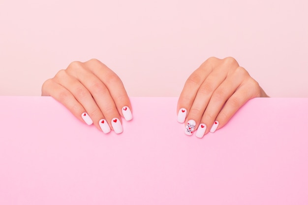 Beautiful female hands with white manicure
