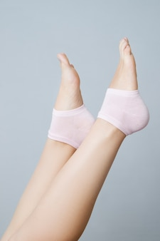 Beautiful female legs in pink socks. foot care