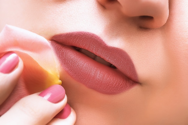 Beautiful female lips with dark lipstick, close up