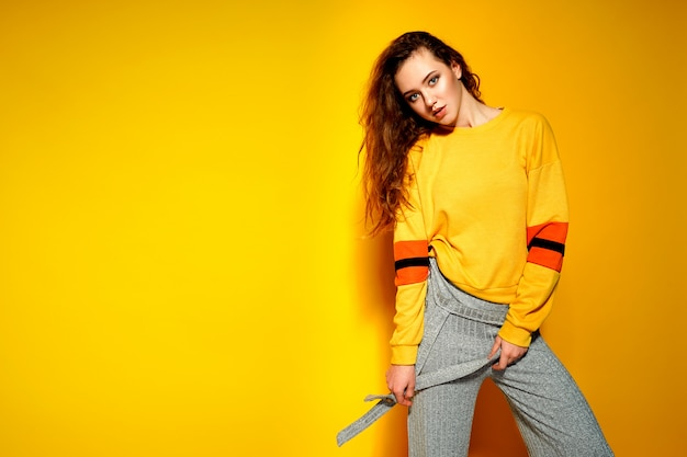 Beautiful female model wears casual comfrotable sweater