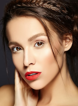 Beautiful female model with fresh daily makeup with red lips