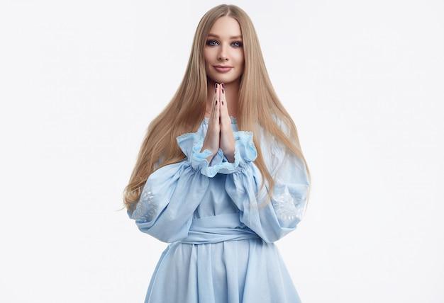Beautiful female model with long hair posing in fashion dress