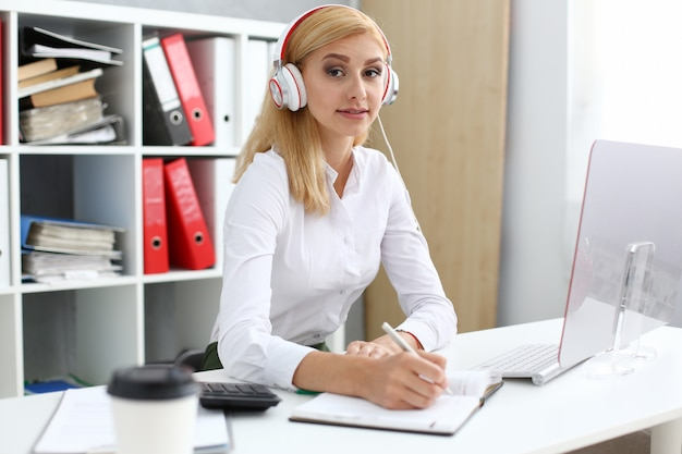 Beautiful female student with headphones listening