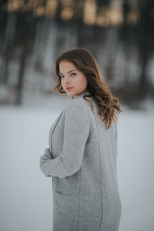Beautiful female in a winter snowy forest