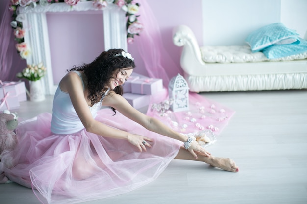 Beautiful feminine girl in an elegant pink outfit of a ballerina