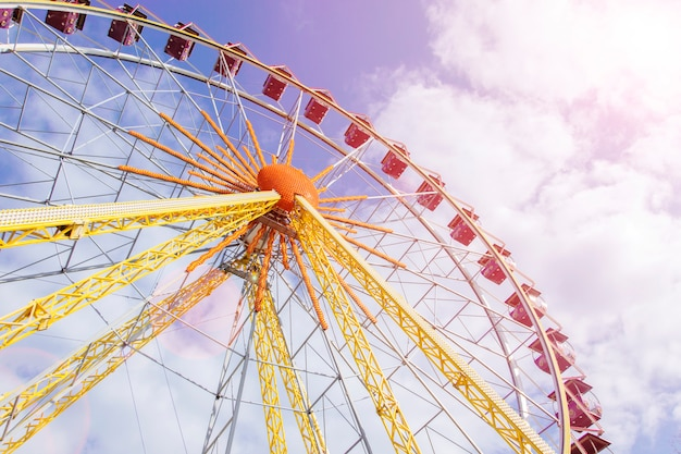 Beautiful ferris wheel on the background of  sunny sky