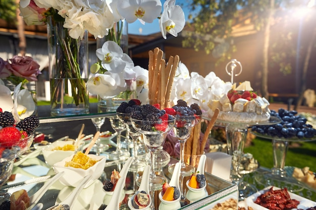 Beautiful festive buffet with flowers and food