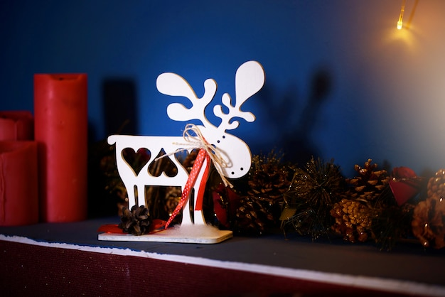 Beautiful festive christmas decor with lights, christmas trees, bokeh, toys.