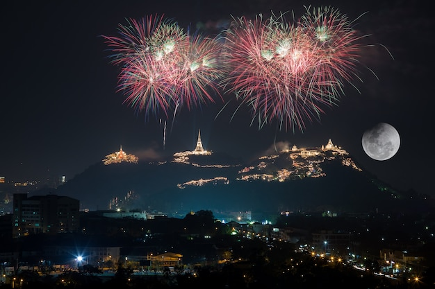 Beautiful firework on mountain  for celebration with full moon light