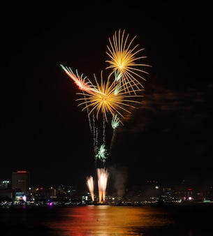 Beautiful firework at pattaya coast with cityscape, thailand