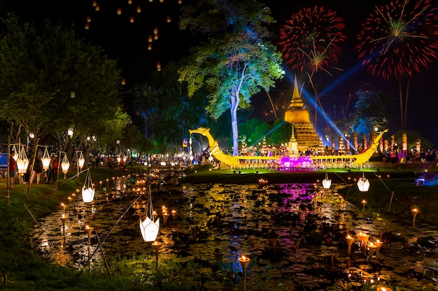 Beautiful firework reflection over old pagoda loy krathong festival sukhothai thailand amazing historic town. colorful, city.