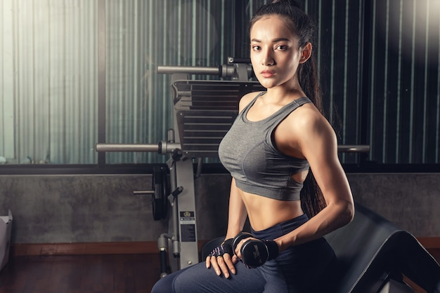 Beautiful fit asian woman at the gym