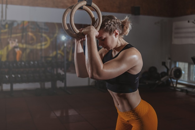 Beautiful fit crossfit woman exercising