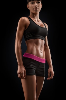 Beautiful fitness female slim tanned body