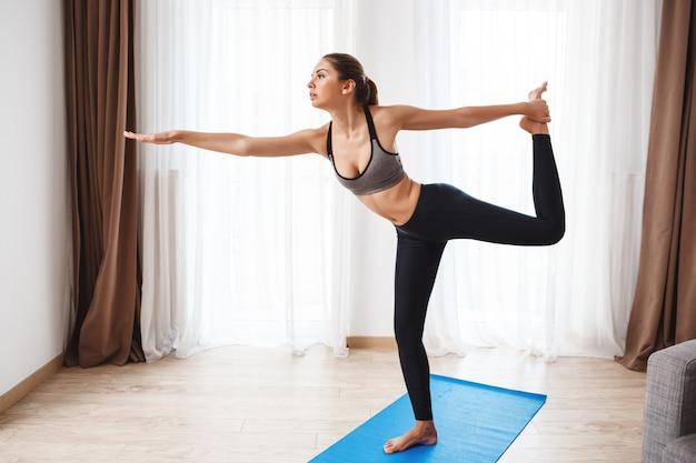 Beautiful fitness girl  performing yoga