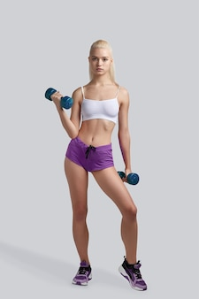 Beautiful fitness girl working out