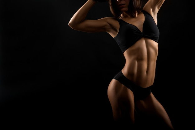 Beautiful fitness woman at the studio