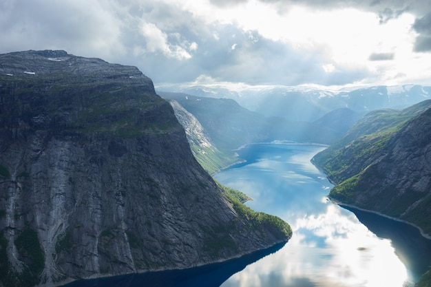 Beautiful fjord in norway with amazing sun rays