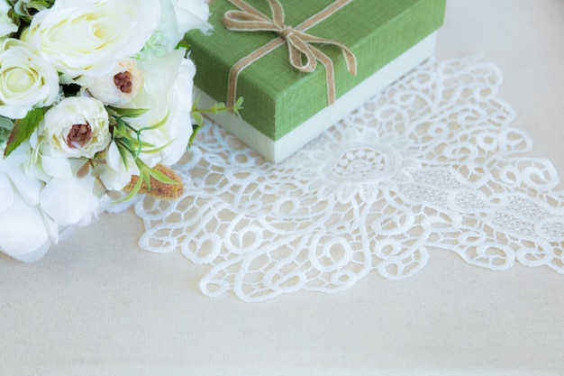 Beautiful flat lay lace flower bouquet and gift box background