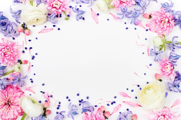 Beautiful floral arrangements. frame made of ranunculus, chrysanthemum and other flowers on white background. flat lay, top view.