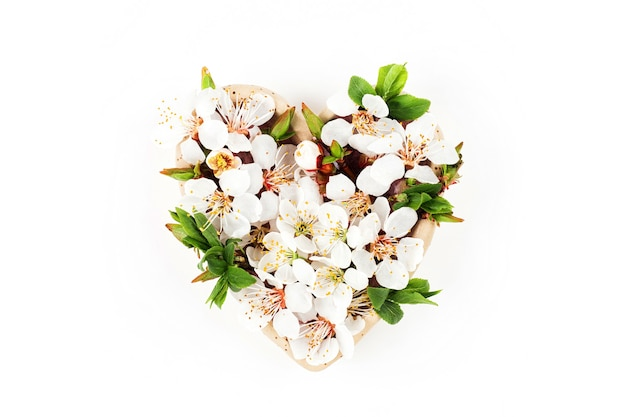 Beautiful  floral arrangements. spring flowers in the shape of heart.  flat lay, top view.
